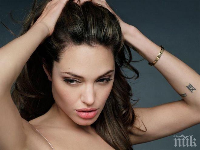 КРАЙ! Тайната за татуировките на Анджелина Джоли е разбулена