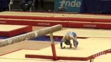 Екшън! Абсолютна световна шампионка по гимнастика се приземи на глава след изпълнение на греда (ВИДЕО)