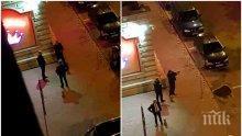 ДИВИЯТ ЗАПАД! Охранители стрелят с пистолет в София, край тях минават хора и коли (СНИМКИ)