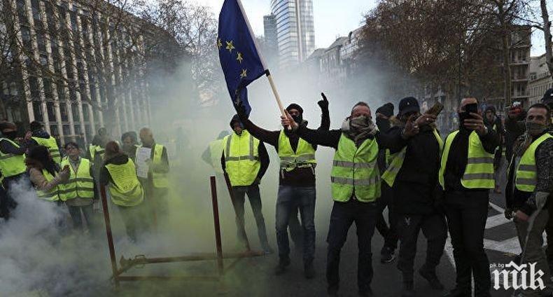 И в Лондон облякоха жълти жилетки срещу стягането на коланите
