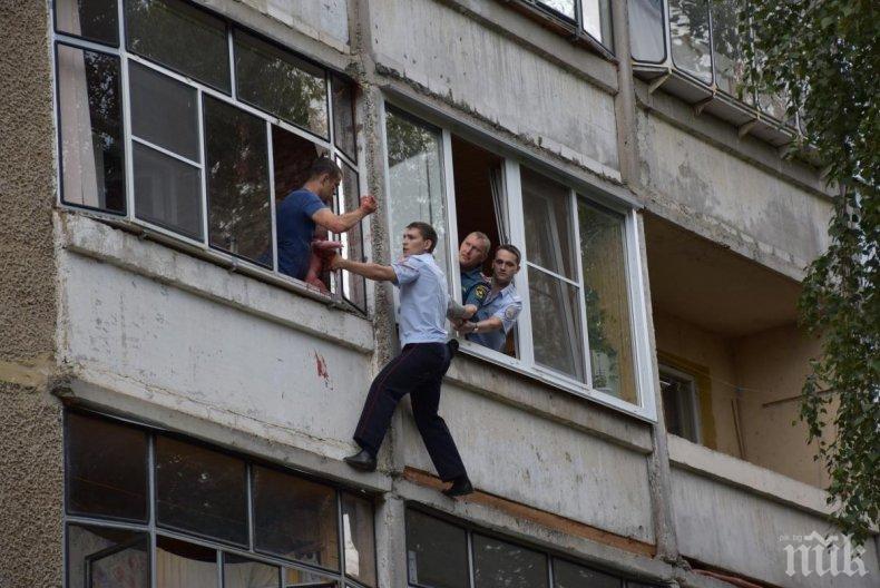 ШОКИРАЩИ КАДРИ: Спасиха бебе, чийто пиян баща заплашваше да го изхвърли през балкона (ВИДЕО 18+)