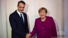 Мицотакис увери Меркел, че ще спазва Преспанския договор