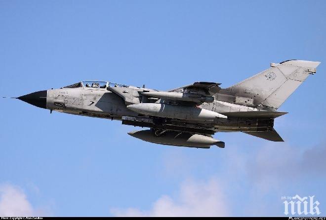 Самолет без обозначения удари база на подкрепяна от Иран милиция в Ирак