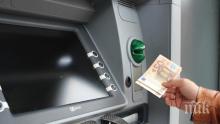 Задържаха българи в Португалия за източване на банкови карти